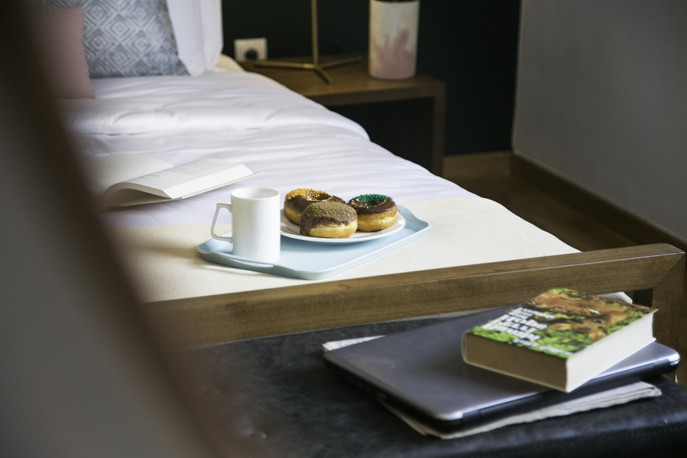corporate traveler taste of home donuts on bed breakfast