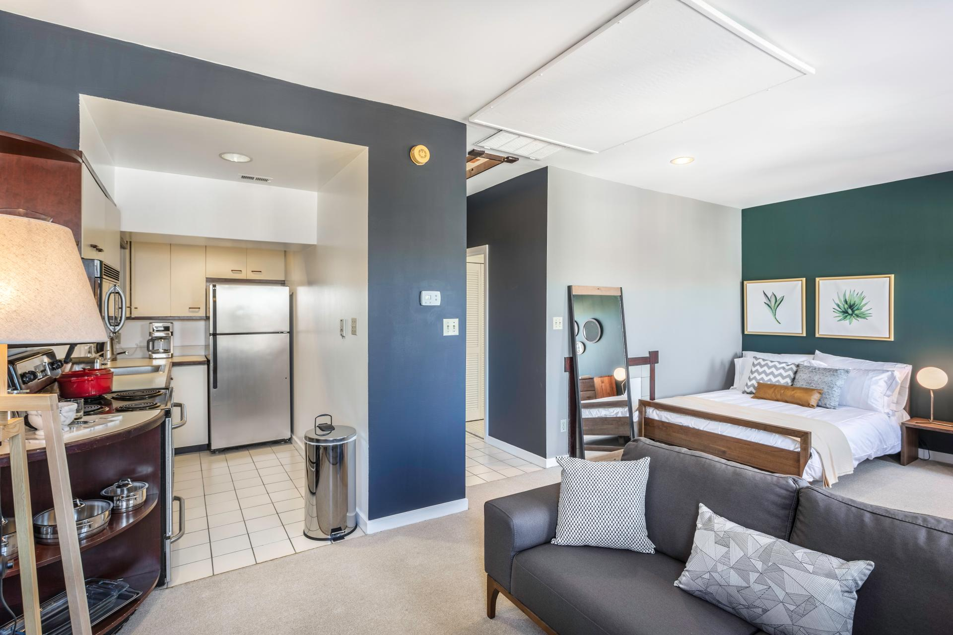 blueprint blueground Georgetown apartments DC studio apartment with blue and green walls and grey couch